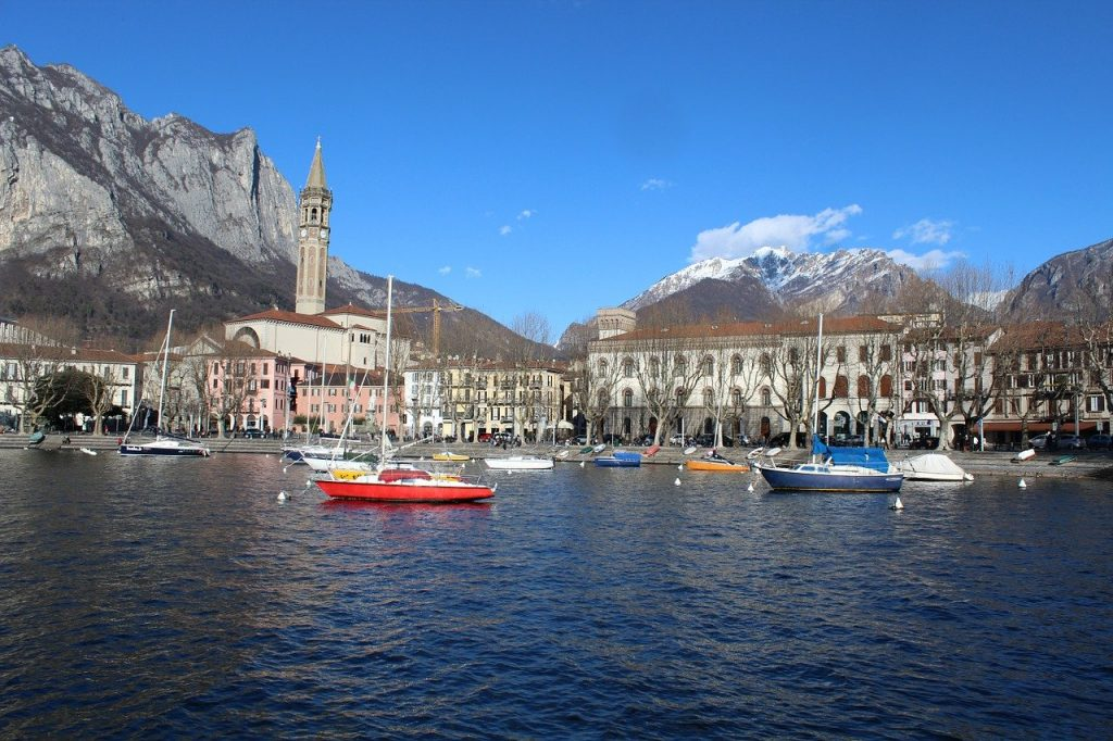 boats on lake Como by the town frontage of Lecco